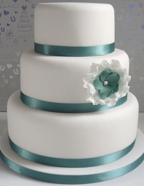 Three Tier Round White Wedding Cake With Green Ribbons And White And Green Faux FlowerJPG