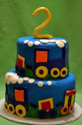 Two tier round blue second birthday cake with trains and the number 2 on top.JPG
