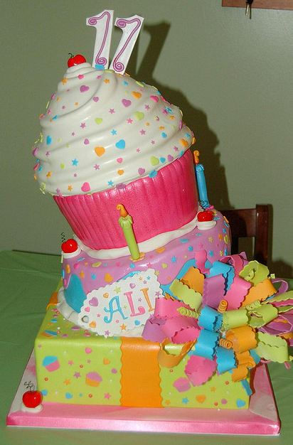 tier birthday cake for 11-year-old with giant cupcake on top.JPG