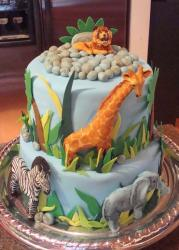 Two tier safari theme cake with lion giraffe zebra and elephant.JPG