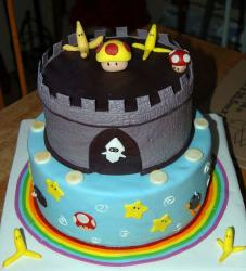 Two tier Mario Kart theme cake with bananas.JPG