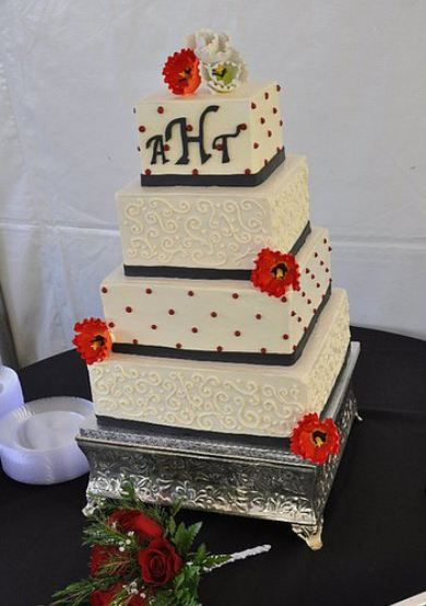 Four Tier White Buttercream Square Wedding Cake With Red