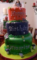 Three tier red purple green birthday cake.JPG