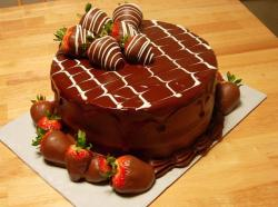 Round chocolate cake with chocolate dipped strawberries.JPG