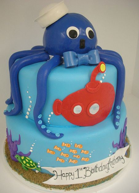 Two tier ocean theme first birthday cake with blue octopus on top.JPG