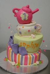 Tri-tier first birthday cake with pink teapot on top.JPG