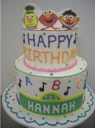 Two tier Sesame Street theme birthday cake.JPG