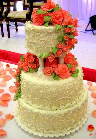 three tier wedding cake with roses 3 tier ivory vanilla wedding cake with flowers and 20956