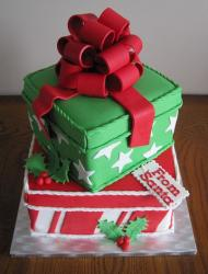 Two tier green and red Christmas gift box cake with red bow.JPG