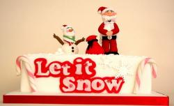 White Christmas cake with snowman and young Santa and Let it Snow.JPG