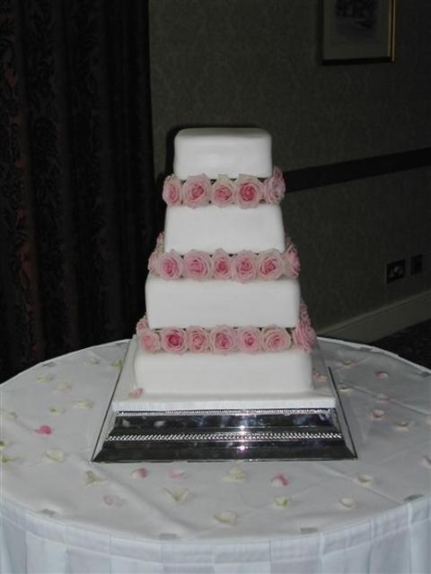 square wedding cake with light pink roses