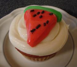 Cupcake with white buttercream and watermelon slice fondant topper.JPG