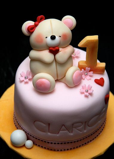 Cute round pink first birthday cake with teddy bear on top.JPG