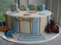 Round baby shower cake with baby blocks and pacifiers.JPG