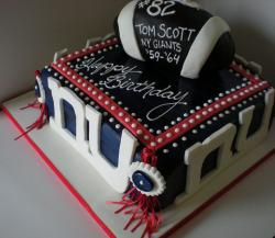 New York Giants football theme birthday cake with football on top.JPG