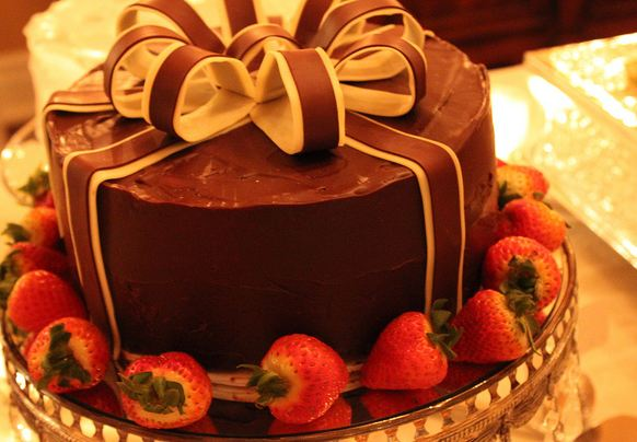 Round Chocolate Cake With Bow And Fresh Strawberries