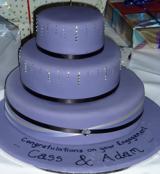 Chic dark purple engagement cake in three tiers.PNG