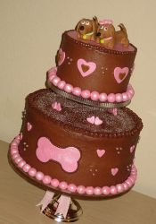 Chocolate engangement cake with two dogs cake topper.PNG