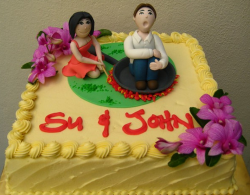 Funny engagement cake with bride to be cooking her future husband.PNG