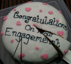 Homemade engagment cake with small cute pink hearts.PNG