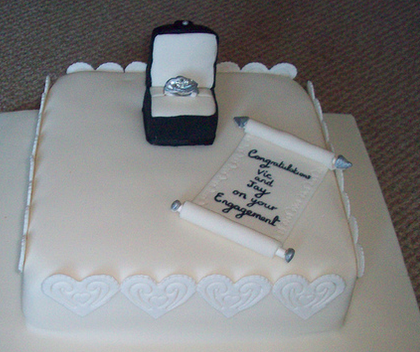 square engagment cake with engagement ring in the box png