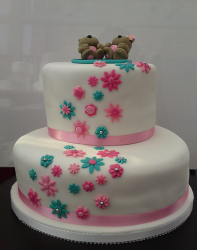 Two tier cute engagement cake with bears cake toppers and small flowers.PNG
