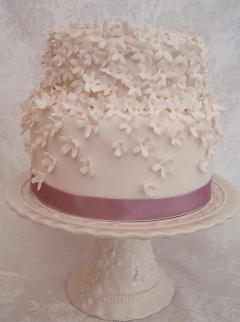 White floral engagement cake with pink ribbon.PNG