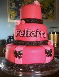 Pink round 3 tier birthday cake with brown band and bowtie accents.JPG