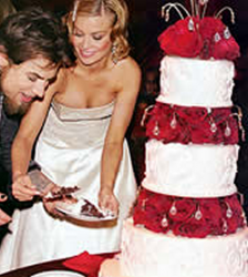 Carmen Electra celebrity 4 tier wedding cake with red roses and crystal cake decor.PNG