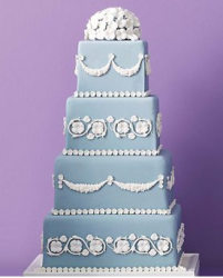 Chic blue wedding cake with white flowers cake decor.PNG