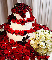 Denise Richards wedding cake with fresh roses.PNG