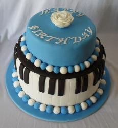 Two tier piano theme birthday cake with blue and white beads.JPG