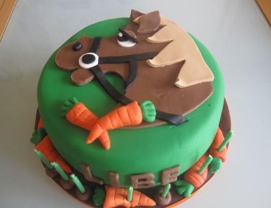 Round green horse theme cake.JPG