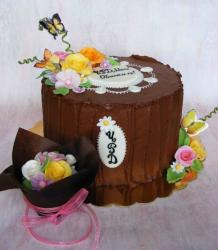 Round chocolate cake with floral decor and monogram.JPG