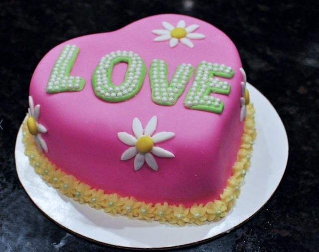 Love Shape Cake Images : Heart-shaped Pink Valentine Cake with the word LOVE.JPG Hi ...
