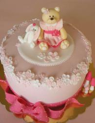 Round light pink cake with teddy bear in pink dress and rabbit.JPG