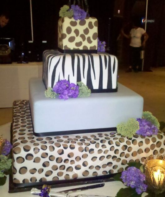 Four tier square wedding cake with different animal stripes and spots.JPG