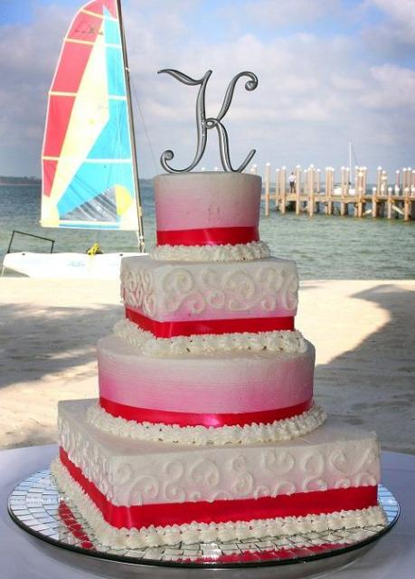 red and white wedding cake toppers white wedding cake in 4 tiers with pink hue and letter 19106