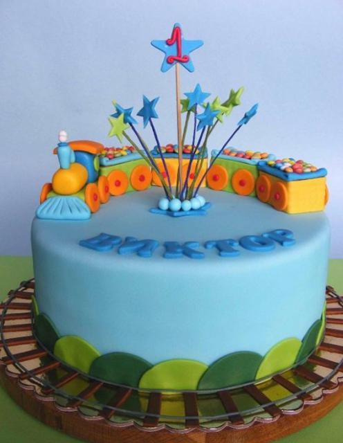 Powder blue train theme birthday cake with tracks for one-year-old.JPG