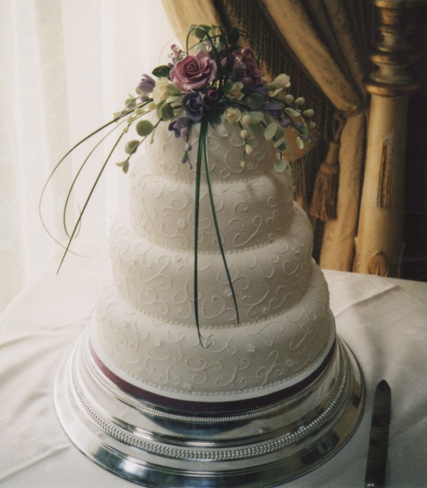 Image Of White Wedding Cake With Fresh Flowers Topper