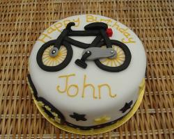 Round white bicycle theme birthday cake.JPG
