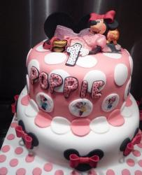 Two tier pink and white Minny Mouse first birthday cake.JPG