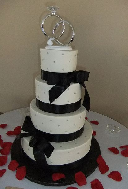 4 Tier White Round Wedding Cake With Black Bows And