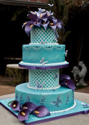 Four tier teal wedding cake with butterfly imprints and purple flowers.JPG