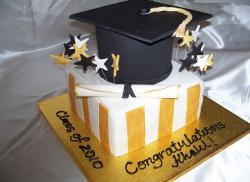 Black cap and square white and gold graduation cake.JPG