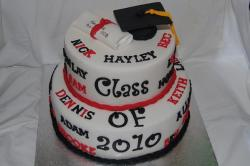 Two tier round white graduation cake with cap and diploma.JPG