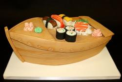Sushi on a boat cake with wasabi and pickled ginger.JPG