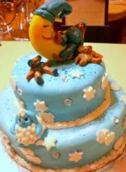 Two tier blue baby shower cake with sleeping crescent moon.JPG