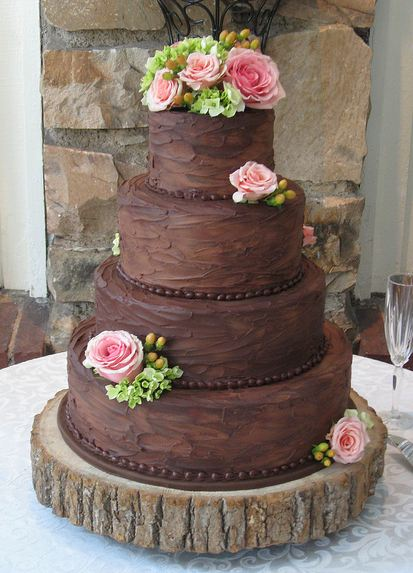 chocolate wedding cake with pink flowers four tier chocolate wedding cake with pink roses jpg 12811
