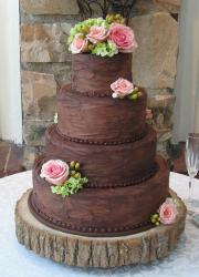 Four tier round chocolate wedding cake with pink roses.JPG